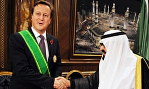King Abdullah of Saudi Arabia decorates David Cameron