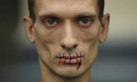 Pyotr Pavlensky with sewn up mouth