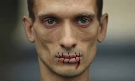 Pyotr Pavlensky with sewn up mouth