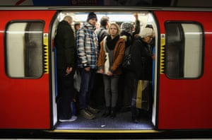 Commuters squeeze on to a tube at Oxford Street.