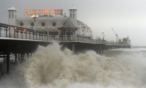 Waves pound the seafront in Brighton. See the best UK storm images in our gallery.