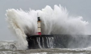 Newhaven Lighthouse is battered by waves during stormy weather.