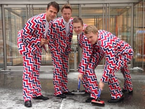 Members of the Norway's Men's Olympic Curling Team from left Thomas Ulsrud, Torgor Nergard, Christoffer Svae, and Havard Vad Petersson wear their new Sochi 2014 suits as they pose for a photographer in New York.