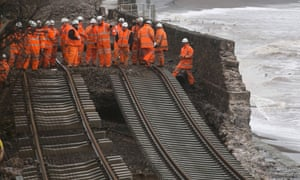 Railway workers inspect the main Exeter to Plymouth railway line that has been closed due to parts of it being washed away by the sea at Dawlish.