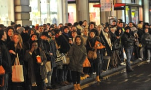 Londoners wait for a bus on Oxford Street after a strike by Tube workers caused chaos in the capital