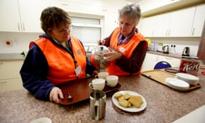 Volunteers Verity Trevor-Morgan and Marsha Casely make cups of tea at a rest centre that has been set up at North Petherton bowling club for potential victims of flooding in Devon.