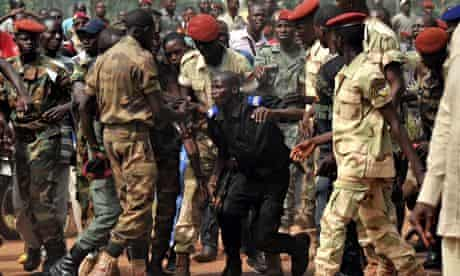Members of the Central African Armed Forces surround a gendarme