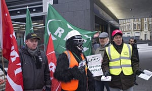 Striking tube workers on a picket line at King's Cross underground station