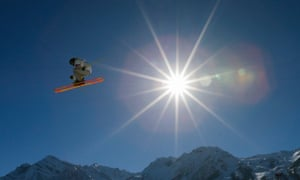 A competitor takes a jump during a ski slopestyle training session at the Rosa Khutor Extreme Park, prior to the 2014 Winter Olympics.