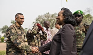 Central African Republic president Catherine Samba-Panza shakes a soldier's hand