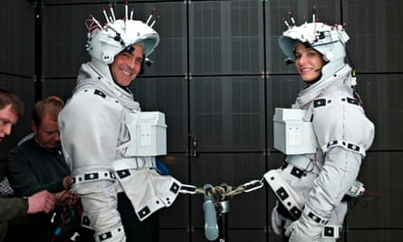 George Clooney and Sandra Bullock are hooked up together on the set of Gravity.