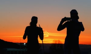 Athletes take pictures during a biathlon training session ahead of the Sochi 2014 Winter Olympics at the Laura Cross-Country Ski and Biathlon Center on February 6, 2014 in Sochi, Russia. The make of phone isn't clear.