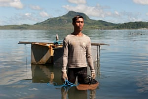 Joel, a fisherman who lost his boat and fishing equipment during the typhoon now earns a living selling scrap metal that he finds along the shore in Anibong Bay.