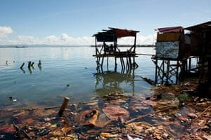 Joel and his partner May-May live in a house on stilts above the water in Rawis, Anibong Bay, Tacloban that Joel built using wood salvaged from the storm wreckage and a tarpaulin provided by Oxfam.