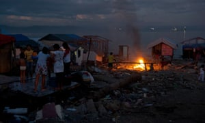 Night falls in an area of Tacloban which gets most of its electricity from a wrecked ship's generator.