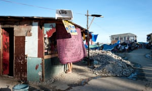 In a badly-hit part of Tacloban, a shop offering phone credit has already been built and is well stocked.