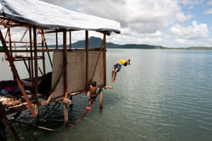 Houses on stilts have been built using wood salvaged from the storm wreckage and tarpaulin provided by Oxfam in Rawis, Anibong Bay, Tacloban.