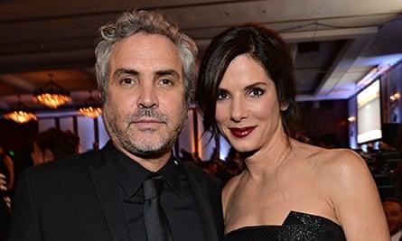 Alfonso Cuarón and Sandra Bullock.