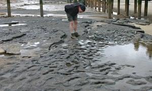 Footprint hollows on the beach at Happisburgh, Norfolk