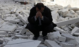 A site in Aleppo hit by what activists said was a barrel bomb