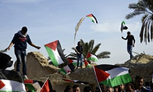 Palestinians with flags at the Ein Hijleh protest camp