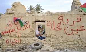 A  Palestinian activist sits inside a structure in Ein Hijleh