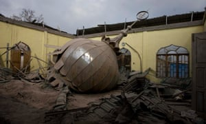 A collapsed mosque dome is seen covered with volcanic ash from the Mount Sinabung eruption at Kuta Gugung village in Karo, Indonesia. More than 31,000 people have now sought refuge in government buildings, mosques and churches.