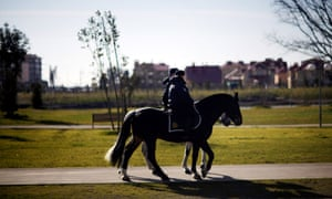 Police patrol though a park on horseback outside the Olympic Park ahead of tonight's 2014 Winter Olympics opening ceremony in Sochi, Russia.