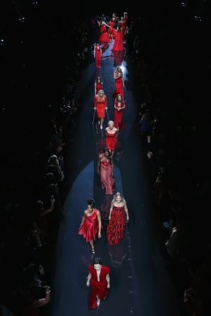 Models walk the runway during Go Red For Women The Heart Truth Red Dress Collection 2014 Show at The Theatre at Lincoln Centre in New York City.