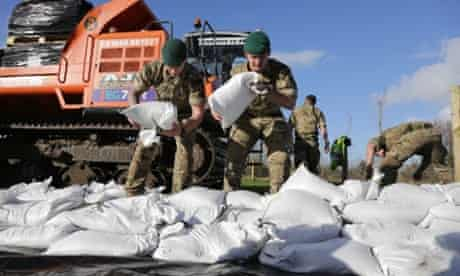 Royal Marines from 40 Commando help build a sandbag wall around a property in Moorland as they help with flood defences on the Somerset Levels near Bridgwater on February 7, 2014