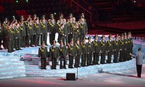 A military choir performs during the Opening Ceremony of the Sochi Winter Olympics at the Fisht Olympic Stadium.