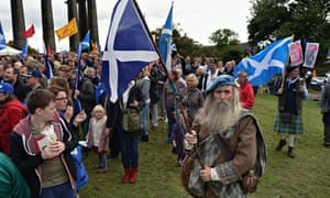 Pro-independence campaigners attend a rally in Edinburgh.
