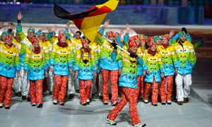 Skier Maria Hoefl-Riesch of the Germany Olympic team carries her country's flag during the Opening Ceremony of the Sochi 2014 Winter Games.