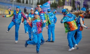 Olympic volunteers dance in the Olympic Park at the Sochi 2014 Olympic Games.