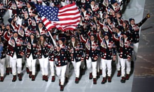 Nordic combined skier Todd Lodwick of the United States carries his country's flag during the Opening Ceremony of the Sochi 2014 Winter Olympics