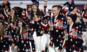 Athletes from the United States wave to spectators as they arrive during the opening ceremony of the 2014 Winter Olympics in Sochi.