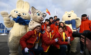 Athletes from San Marino pose with the Olympic mascots ahead of the Sochi 2014 Winter Olympics.