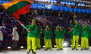 Lithuania's flag-bearer Deividas Stagniunas leads his country's contingent as they march in during the opening ceremony of the 2014 Sochi Winter Olympics.