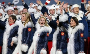 Russian athletes wave to spectators as they arrive during the opening ceremony of the 2014 Winter Olympics in Sochi, Russia.