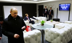Russian President Vladimir Putin waits in the presidential lounge to be introduced at the opening ceremony of the Sochi 2014 Winter Olympics.