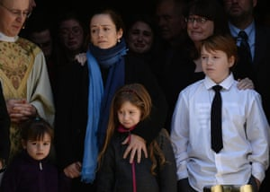 Former partner of Phillip Seymour Hoffman, Mimi O'Donnel with their children Tallulah (L) Willa and Cooper Alexander watch the US actor's coffin leave the funeral mass at St Ignatius Church in New York.