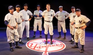 "Peter Scolari, portraying baseball legend Yogi Berra, right, and the cast from the play, ""Bronx Bombers,"" which examines the history of the New York Yankees."