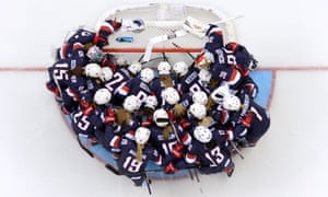 US players gather before the start of the women's ice hockey group A match USA vs Finland at the Shayba Arena .