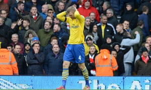 Arsenal's Per Mertesacker. And an anonymous gesture, left.