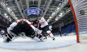 Canada's Tara Watchorn scores against Switzerland.