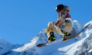 Sage Kotsenburg of the US performs a jump during the men's snowboard slopestyle semi-final competition at the 2014 Sochi Olympic Games.