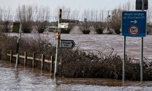 UK floods: political blame game deepens as weather warnings persist
