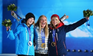 Silver medalist Enni Rukajarvi of Finland, gold medalist Jamie Anderson of the United States and bronze medalist Jenny Jones of Great Britain with their women's snowboard slopestyle Olympic medals.