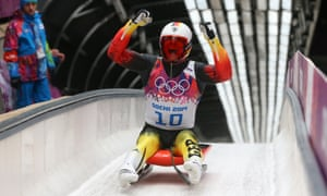 Felix Loch of Germany celebrates winning the gold medal in the men's singles luge at the Sochi 2014 Winter Olympics.