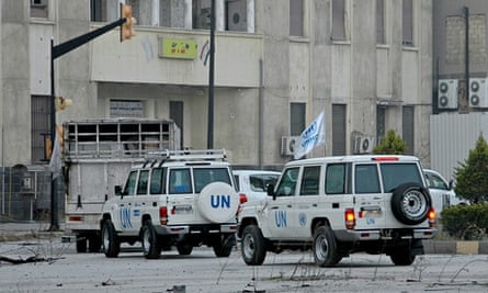 convoy of United Nations and Syrian Red Crescent vehicles entering the regime-held areas of Homs